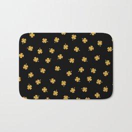 Golden shamrocks Black Background Bath Mat