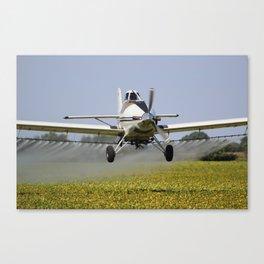 Airplane Spraying a Field Canvas Print