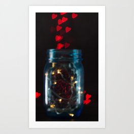 Blue mason jar with fairy lights and a red heart bokeh background Art Print