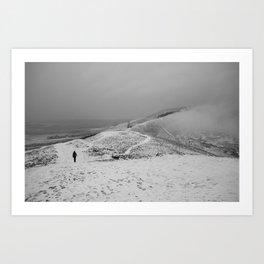 Walker on snow covered peaks. Mam Tor above Castleton, Peak District, Derbyshire, UK Art Print
