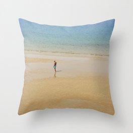 A Man on La Concha Beach in San Sebastian, Spain Throw Pillow