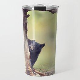 Young black bear behind of the tree Travel Mug