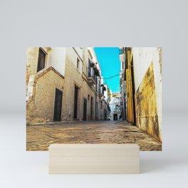 Little alley in the medieval center of the white village of Locorotondo Mini Art Print