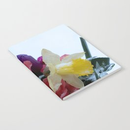 Vibrant bouquet of flowers in the snow Notebook