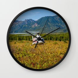 Helicopter landed in an autumn landscape Wall Clock