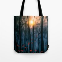 trees Tote Bags featuring Red feather dance  (colour option) by Viviana Gonzalez