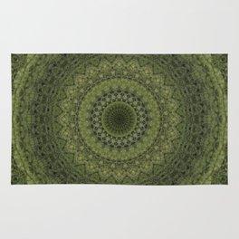 Green mandala with hern ornaments. Rug