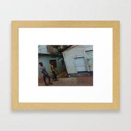 Kids smiling in Dominican street Framed Art Print