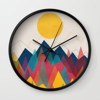 budi satria kwan Wall Clocks featuring Uphill Battle by Picomodi