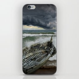 Shipwrecked Wooden Boat amidst Crashing Waves iPhone Skin