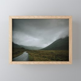 Gloomy days on the road in the Scotland wilderness Framed Mini Art Print