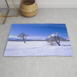 Winter landscape with two trees and clear blue sky Rug