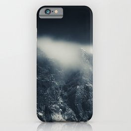 Darkness and white clouds over the mountains iPhone Case