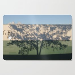 Shadow Tree on an industrial building Cutting Board