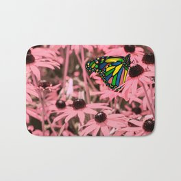 Surreal Monarch on Pink Flowers Bath Mat