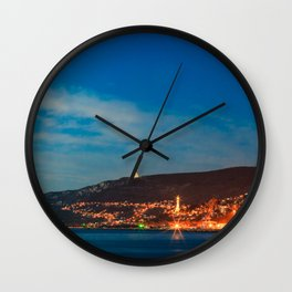 Colorful sunset in front of the city of Trieste Wall Clock