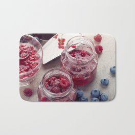 homemade raspberry, blueberry and red currant jam Bath Mat