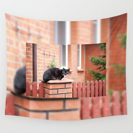 lonely stray black cat sitting Wall Tapestry