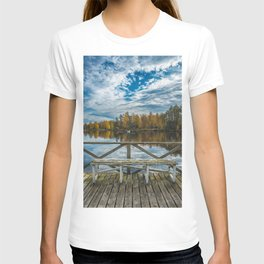 Picture of blue sky over autumn lake and wooden pier with the bench T-shirt