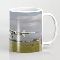 manchester Mugs featuring AN225 departing Manchester by Jid Webb