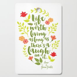 Life is worth living as long as there's a laugh in it. Anne of Green Gables. Cutting Board