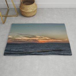Summer sunset on lake Ontario Rug