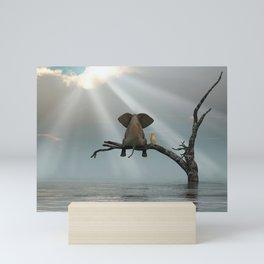 elephant and dog sit on a tree during a flood Mini Art Print