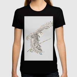 The snowy owl in flight with his wing touching the snow T-shirt