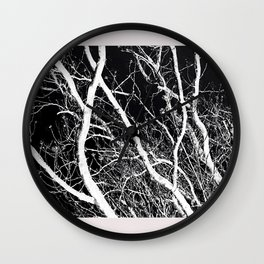 A Reversal Of Light With Trees Wall Clock