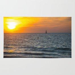 Sunset on the beach Rug