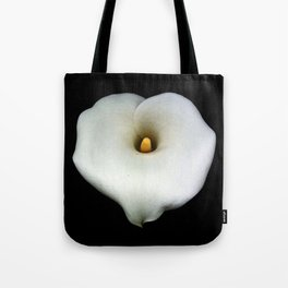A Single Heart Shaped Calla Lily Isolated On Black Tote Bag