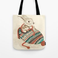 bunny Tote Bags featuring cozy chipmunk by Laura Graves