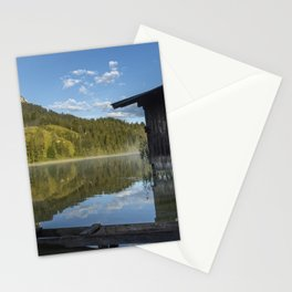 Lake water reflections with boathouse. Amazing shot of a wooden house in the Ferchensee lake in Bavaria, Germany, in front of a mountain belonging to the Alps. Stationery Cards