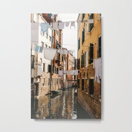 CLOTHING HANGING ON CABLE BETWEEN CONCRETE HOUSES Metal Print