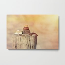 Balanced stone cairn in sunset light Metal Print