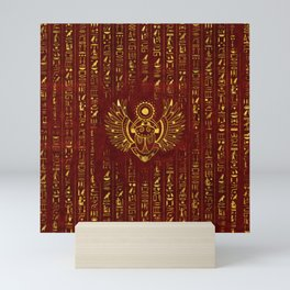 Golden Egyptian Scarab Ornament  on red leather Mini Art Print