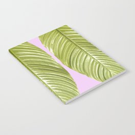 Three large green leaves on a pink background - vivid colors Notebook