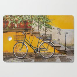 Bicycle Parked at Wall, Lucca, Italy Cutting Board