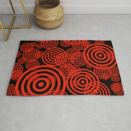 Hypnotizing circles - red on black Rug