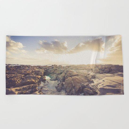 Golden hour, rocky beach landscape Beach Towel