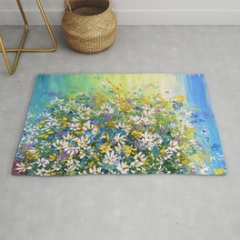 A picture with a bouquet of field daisies in a vase. Rug