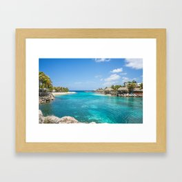 Blue water lake with huts and palm trees around Framed Art Print