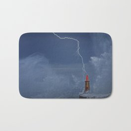 Lightning and wave over old lighthouse. Bath Mat