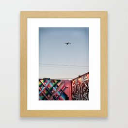 Plane in night sky Framed Art Print