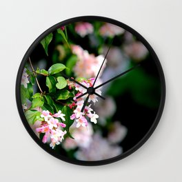 Spring Into Action Wall Clock