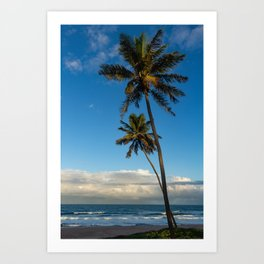 Sunset on the edge of the sea. Two huge palm trees pointing to the sky. Art Print