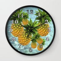 pineapples Wall Clocks featuring Pineapples by Erika Kaisersot