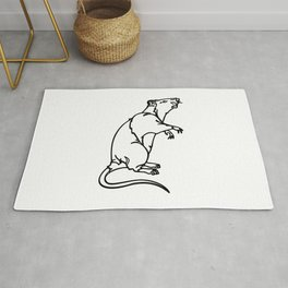 A Rat Standing on its legs Sniffing Rug