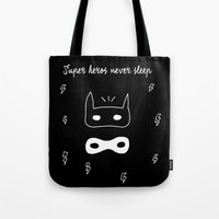 super heroes Tote Bags featuring Super heroes never sleep by Moma le Shop