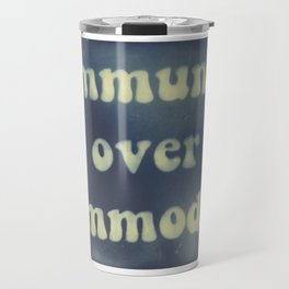 community over commodity Travel Mug
